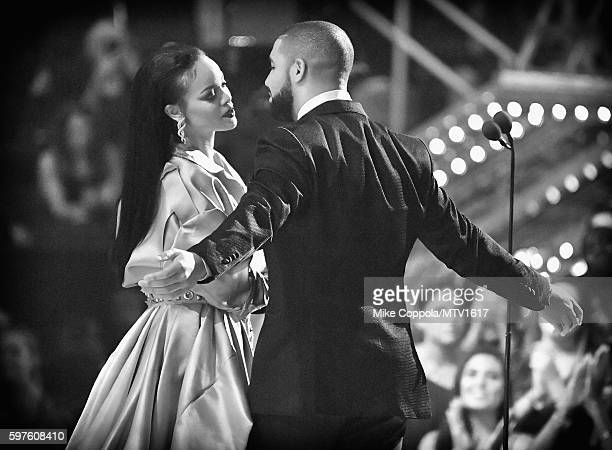 Drake presents the Video Vanguard award to Rihanna onstage during the 2016 MTV Video Music Awards at Madison Square Garden on August 28 2016 in New...