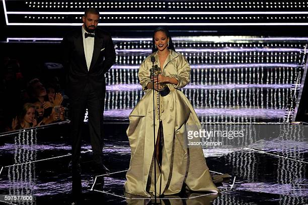 Drake presents the Video Vanguard to Rihanna onstage during the 2016 MTV Music Video Awards at Madison Square Gareden on August 28 2016 in New York...