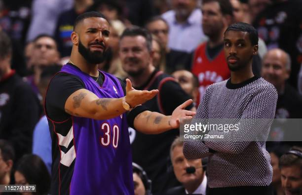 Drake reacts during Game One of the 2019 NBA Finals between the Golden State Warriors and the Toronto Raptors at Scotiabank Arena on May 30 2019 in...