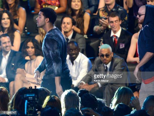 Drake walks past Chris Brown to accept award onstage during the 2012 MTV Video Music Awards at Staples Center on September 6 2012 in Los Angeles...