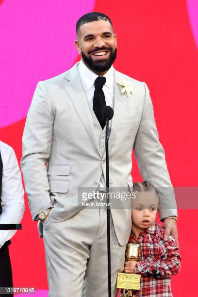Drake, winner of the Artist of the Decade Award, and Adonis Graham speak onstage for the 2021 Billboard Music Awards, broadcast on May 23, 2021 at...