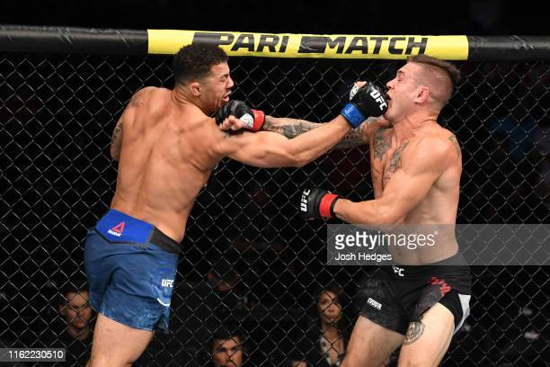 Drakkar Klose and Christos Giagos exchange punches in their lightweight bout during the UFC 241 event at the Honda Center on August 17, 2019 in...