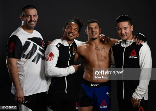 Drakkar Klose poses for a portrait backstage with his team after his victory over Marc Diakiese during The Ultimate Fighter Finale at T-Mobile Arena...