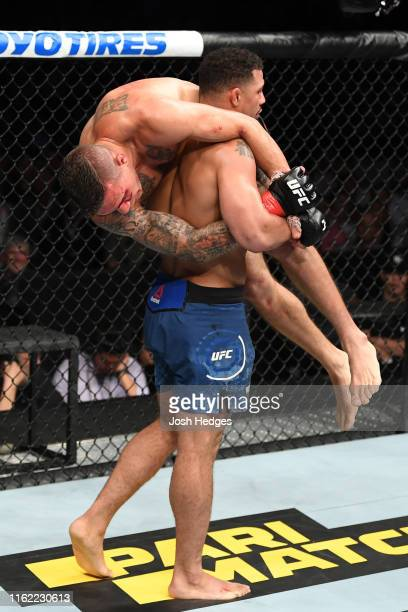 Drakkar Klose prepares to slam Christos Giagos in their lightweight bout during the UFC 241 event at the Honda Center on August 17, 2019 in Anaheim,...