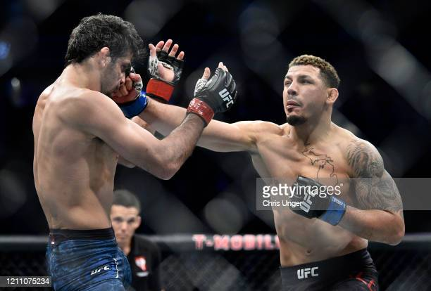 Drakkar Klose punches Beneil Dariush in their lightweight fight during the UFC 248 event at T-Mobile Arena on March 07, 2020 in Las Vegas, Nevada.