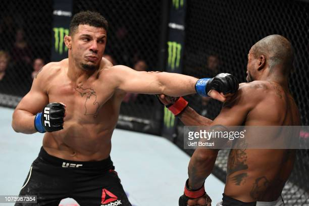 Drakkar Klose punches Bobby Green in their lightweight bout during the UFC Fight Night event at Fiserv Forum on December 15, 2018 in Milwaukee,...