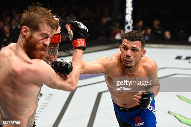 Drakkar Klose punches Devin Powell in their lightweight bout during the UFC Fight Night event inside Talking Stick Resort Arena on January 15, 2017...