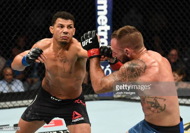 Drakkar Klose punches Lando Vannata in their lightweight fight during the UFC 226 event inside T-Mobile Arena on July 7, 2018 in Las Vegas, Nevada.