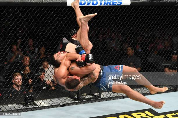 Drakkar Klose slams Christos Giagos in their lightweight bout during the UFC 241 event at the Honda Center on August 17, 2019 in Anaheim, California.