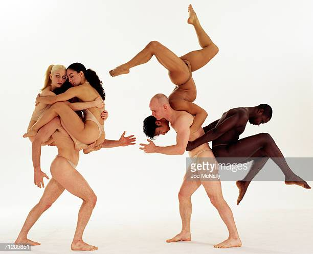 Drama and athletics entwine when members of the Pilobolus dance troupe link bodies to create images like a scorpion right and a crowned warrior on...