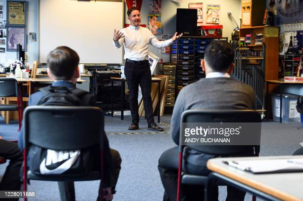 Drama teacher Geoff Nolan gives a socially distanced class to pupils at Holyrood Secondary School in Glasgow for the first time following the easing...