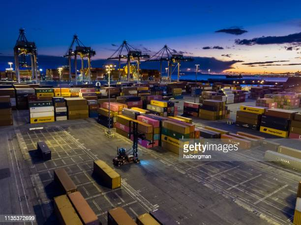 dramatic aerial of container terminal and ships at twilight - port of los angeles stock pictures, royalty-free photos & images