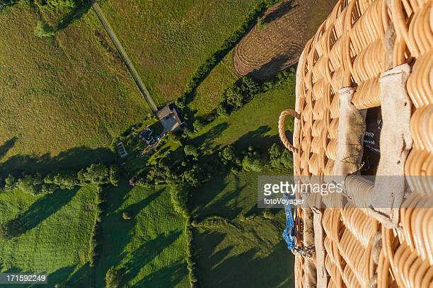 dramatic aerial view from balloon basket over green fields - overhemd en stropdas stock pictures, royalty-free photos & images