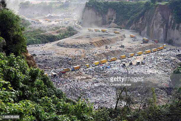dramatic aerial view of landfill in guatemala city - guatemala city stock pictures, royalty-free photos & images