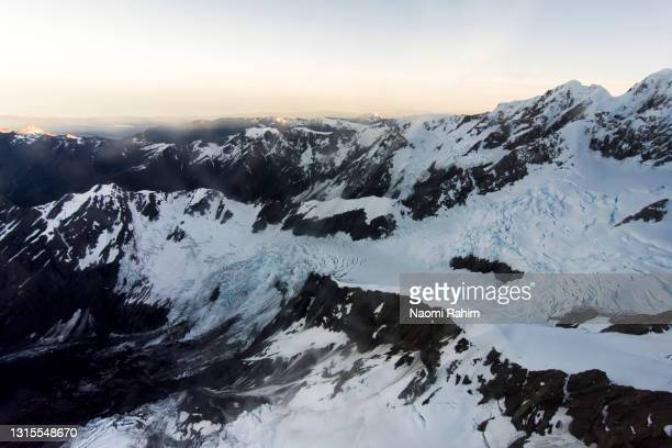 dramatic aerial view of snowcapped mountain range and glacier in new zealand - 2017 stock pictures, royalty-free photos & images