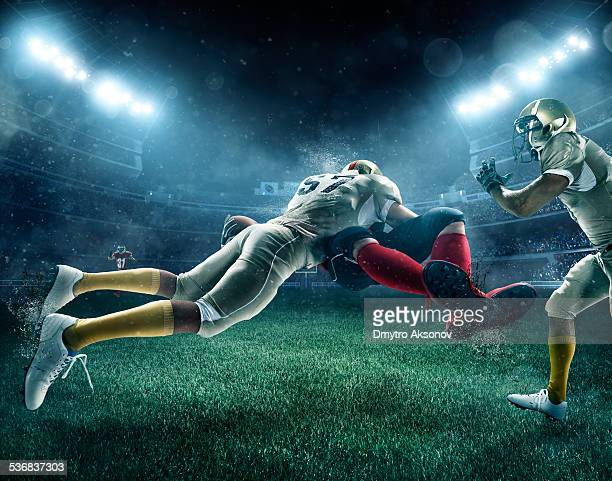 dramatic american football - tackling stock pictures, royalty-free photos & images