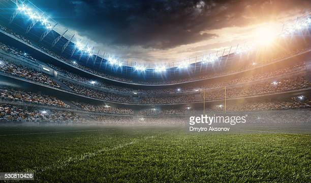 dramatic american football stadium - voetbalveld stockfoto's en -beelden