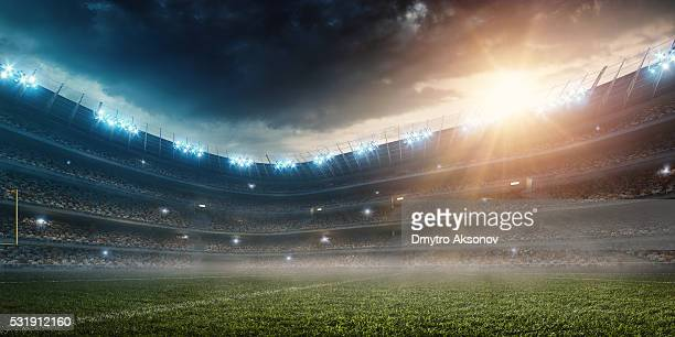 dramatic american football stadium - american football sport stock pictures, royalty-free photos & images