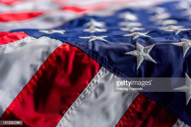 dramatic and dark usa flag background - memorial vigil stock pictures, royalty-free photos & images
