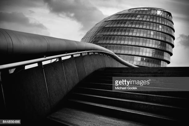 Dramatic angle of London City Hall with staircase in foreground