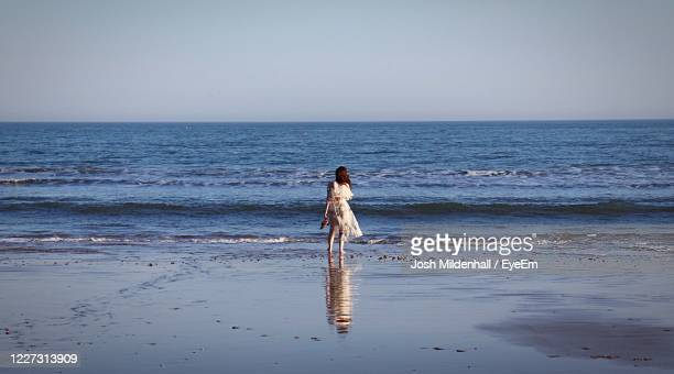 dramatic beach girl - bournemouth southampton stock pictures, royalty-free photos & images