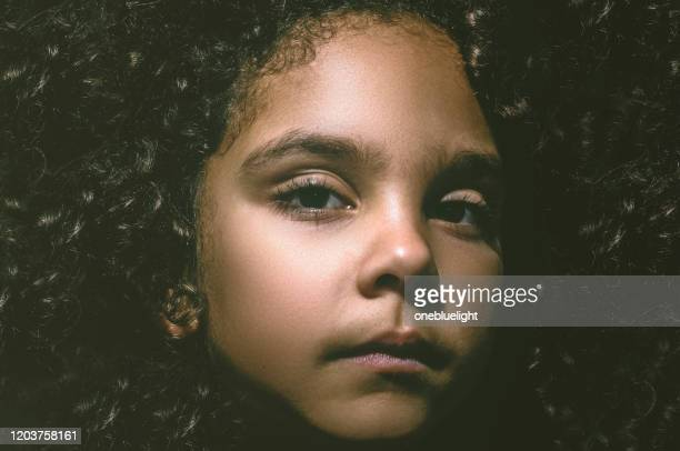 dramatic child (6-7) portrait - onebluelight stock pictures, royalty-free photos & images