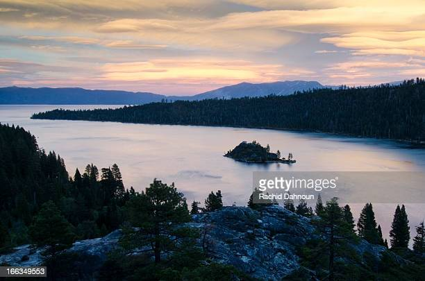 dramatic clouds at sunset over emerald bay in lake tahoe, ca. - emerald bay lake tahoe stock pictures, royalty-free photos & images