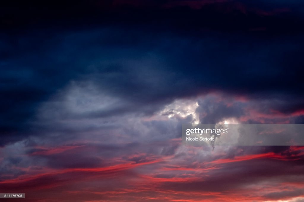 Dramatic clouds at sunset : Stock Photo