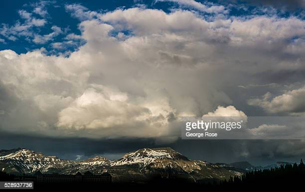Dramatic clouds hug the mountains around the lake on April 23 2016 at Lake Louise Alberta Canada Banff is Canada's oldest National Park and is...