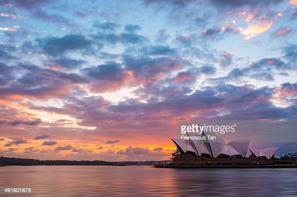 Dramatic clouds just right after sunrise with the foreground of Sydney Opera House