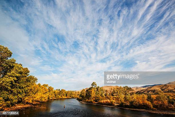 dramatic clouds over boise river in idaho - idaho stock pictures, royalty-free photos & images