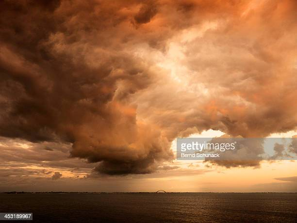 dramatic clouds over seascape - bernd schunack stock pictures, royalty-free photos & images
