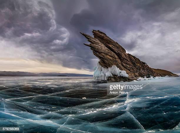 Dramatic clouds over the icy lake. Lake Baikal.