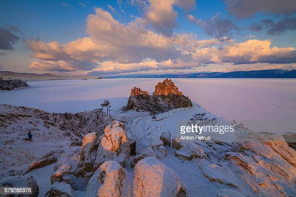 dramatic clouds over the icy lake. lake baikal. - anton petrus stock pictures, royalty-free photos & images