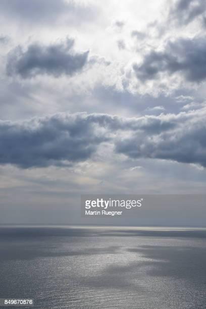 dramatic clouds over the sea. view from capo pecora. - seascape - fotografias e filmes do acervo