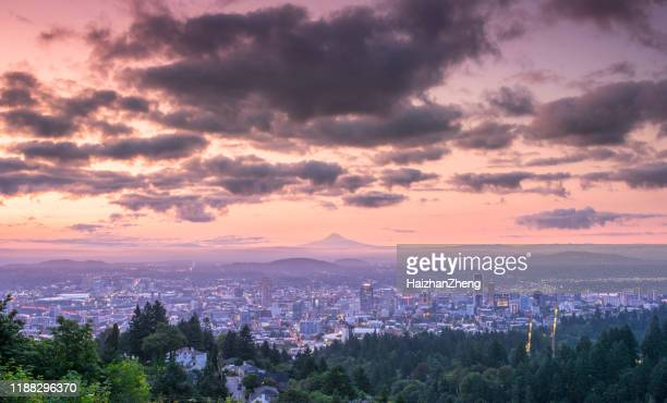 dramatic colorful sunrise over mount hood and foggy portland oregon city downtown - portland oregon stock pictures, royalty-free photos & images