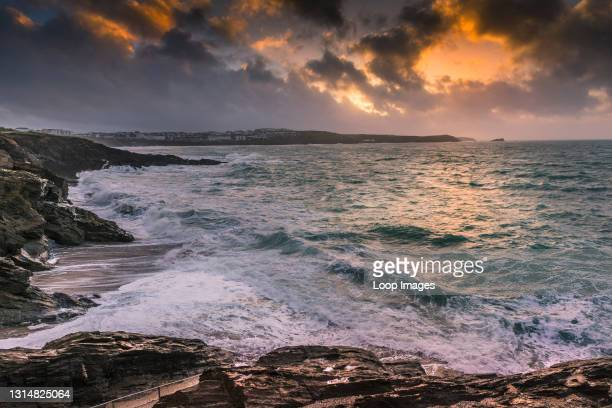 Dramatic Cornish sunset over Fistral Bay in Newquay.