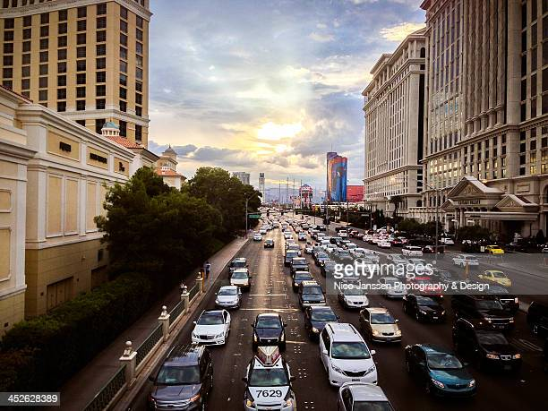 CONTENT] Dramatic desert skies over El Flamingo Road in Las Vegas during sunset with heavy traffic Caesar's Palace on the right the Rio Hotel with...
