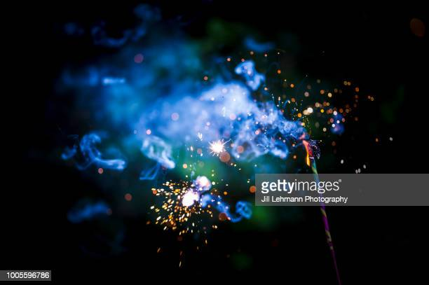 dramatic fire and smoke during 4th of july celebration from sparkler - fourth of july background stock pictures, royalty-free photos & images
