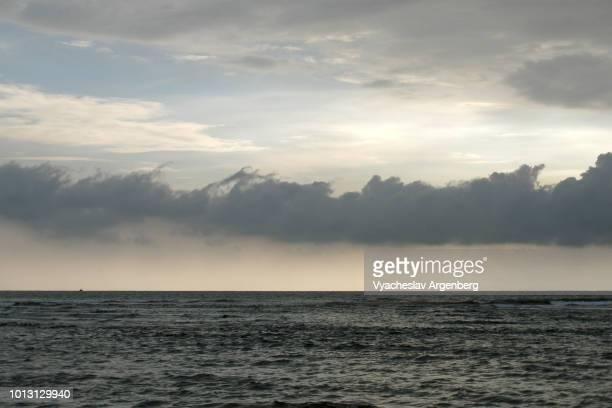 dramatic goan sky full of tropical stormy clouds, mandrem beach, goa, india - argenberg ストックフォトと画像