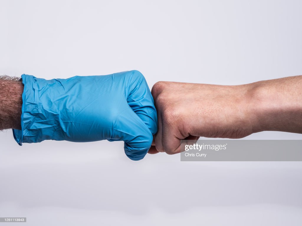 Dramatic handshake with a blue medical glove and a bruised and dirty woman's hand, profile view on white background. : Stock Photo