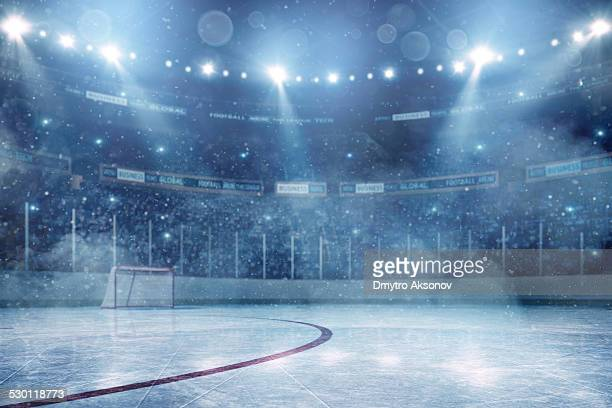 dramatic ice hockey arena - hockey stock pictures, royalty-free photos & images