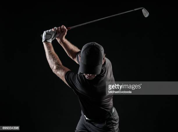 Dramatic Image Of A Male Golfer At The Top Of His Swing