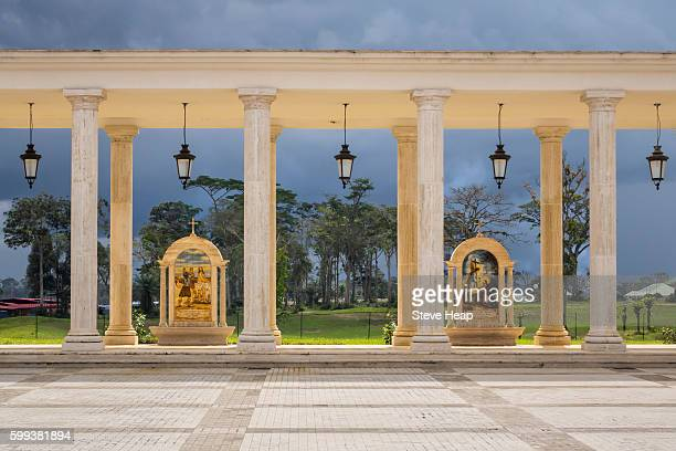 dramatic image of the stations of the cross in the colonnade at the basilica of the immaculate conception of the virgin mary in mongomo, equatorial guinea in africa - guinea ecuatorial fotografías e imágenes de stock