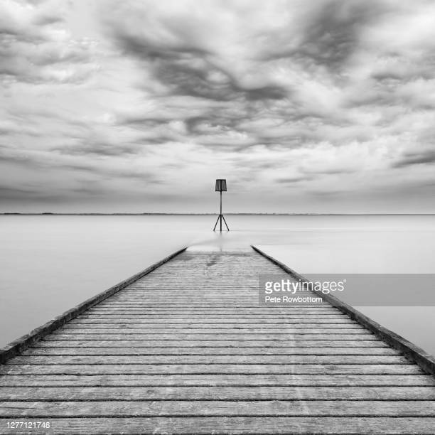 dramatic jetty - horizon over water stock pictures, royalty-free photos & images