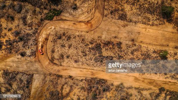 dramatic landscape and car from above, dirt roads - car racing stock pictures, royalty-free photos & images