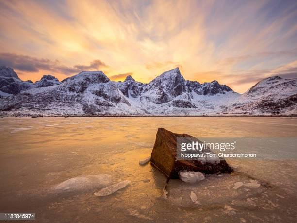 dramatic landscape at lofoten islands, scandinavia, norway - 冠雪 ストックフォトと画像