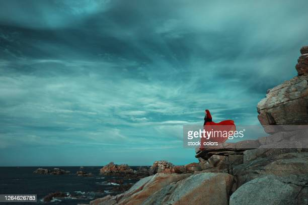 dramatic landscape in spain at the coastline - red dress stock pictures, royalty-free photos & images
