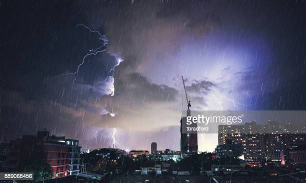 dramatic lightning strike in bangkok, thailand - extreme weather stock photos and pictures