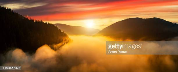 dramatic misty sunrise in the mountains. aerial view - anton petrus panorama of beautiful sunrise stock pictures, royalty-free photos & images